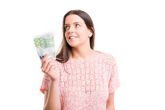 Yes! Extra cash!. Beautiful young woman showing some banknotes Royalty Free Stock Photo