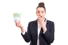 Yes! Extra cash!. Successful business woman showing some banknotes Royalty Free Stock Image