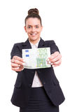 Yes! Extra cash!. Successful business woman showing some banknotes Royalty Free Stock Photography