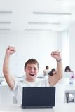 Yes! - happy young male college student Stock Image