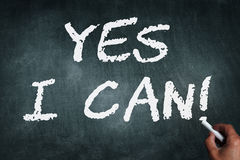 Yes i can. Hand writing with chalk on chalkboard yes i can Royalty Free Stock Photo