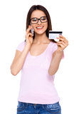 Yes, I'd like to place an order... Shot of a young woman placing a telephonic order with her credit card Royalty Free Stock Photography