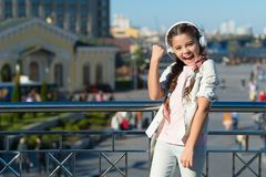 Yes I did it. Happy little girl in earphones showing winner gesture. Small child enjoying stereo sound technology. New. Technology. You cant really imagine royalty free stock photos