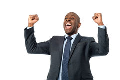 Yes, i did it. Successful male entrepreneur clenching his fists over white Stock Image