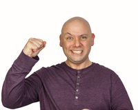 Yes! I won!. Young bald man photographed in the studio on a white background is making a fist and gritting his teeth. Facial expression is achievement, power Royalty Free Stock Images