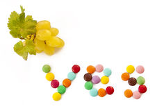 YES inscription of Candy and fresh grapes Royalty Free Stock Images
