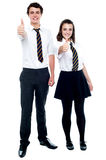 Yes! we made it. School friends gesturing thumbs up after the announcement of results Stock Photos