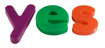YES in magnetic fridge letters Stock Photography