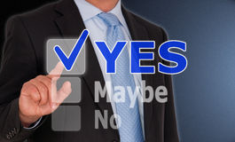 Yes, maybe or no. Touchscreen of a computer in front of businessman in dark suit, blue shirt and tie with buttons for 'yes', 'maybe' and 'no'. His finger is Stock Photo
