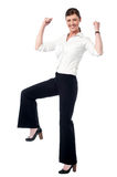 Yes, my team did it!. Full length image of an excited female team leader Stock Image