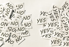 Yes and No. Yes's and No's written on papers on white background Royalty Free Stock Photos