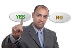 Yes no. Young business man presses the yes button Royalty Free Stock Images