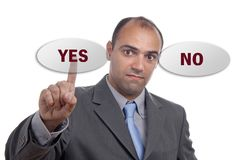 Yes no. Businessman in a suit presses the yes no key Stock Photo