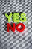 Yes or No?. The words YES and NO written with plastic toy letters Royalty Free Stock Photos
