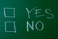 YES or NO on a blackboard Stock Images