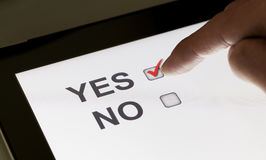 Yes and no checkboxes on a tablet Royalty Free Stock Photos