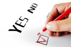Yes or no choice. A hand doing selection with a red pencil vector illustration