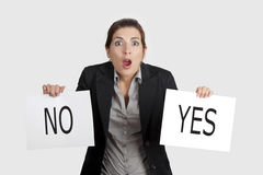 Yes or No choice. Business young woman trying to make a decision between Yes or No choice Stock Images