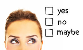 Yes, no, maybe... A picture of a pretty woman thinking about the answer over white background Stock Images