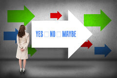 Yes no maybe against arrows pointing. The word yes no maybe and rear view of businesswoman against arrows pointing Royalty Free Stock Image