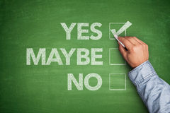 Yes, No or -maybe on Blackboard. Yes, No or -maybe on green Blackboard Stock Photography