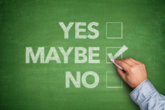 Yes, No or -maybe on Blackboard. Yes, No or -maybe on green Blackboard Stock Photos