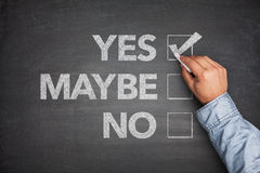 Yes, No or -maybe on Blackboard. With hand Royalty Free Stock Photo
