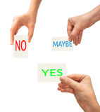 Yes, no, maybe choice concept. Hands holding yes, no and maybe card Stock Photography