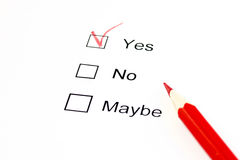 Yes or no or maybe choice. Yes selection with a red pencil Royalty Free Stock Images