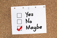 YES NO MAYBE. Choices on cork noticeboard, maybe ticked Royalty Free Stock Images
