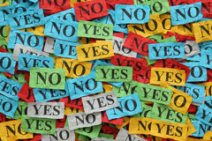 Yes or No?. Pile of crumpled colorful paper notes with words Yes and No Royalty Free Stock Image