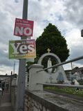 Yes and No posters for the 25th of May referendum regarding the issue of abortion, near the Fatima and the three little shepherds. May 25th, 2018, Cork, Ireland Royalty Free Stock Images
