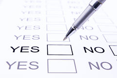 Yes or no questionare with pen Stock Photo