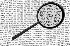 Yes or No. Selecting Yes or No with black magnifying glass, hand drawing Stock Photos