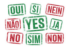 Yes No stamps in multilingual Royalty Free Stock Photo
