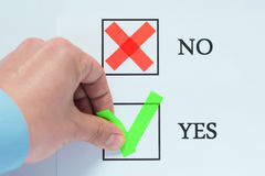Yes No tickbox with green red tick. Hand holding mark Royalty Free Stock Image