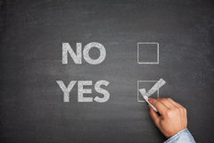 Yes or No, two choices written on the blackboard Stock Images