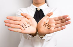 Yes or No? Words on businesswoman hands. Yes or No? Words written on businesswoman hands Stock Photography