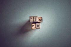 Yes no. On wooden stamps royalty free stock photo