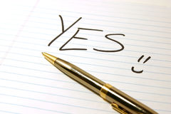 YES - Notepad & Pen Stock Photo