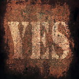 Yes on old rusty metal plate background Royalty Free Stock Images