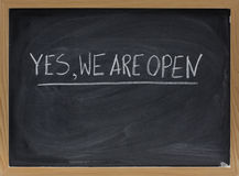 Yes, we are open - business invitation Stock Photography