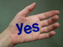 Yes. An open palm with the word yes stock photography