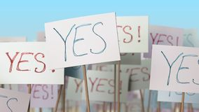 YES placards at street demonstration. Conceptual loopable animation. Placards at street demonstration. Loopable animation stock footage