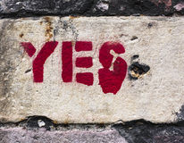 YES!  Red letters stenciled on concrete wall Royalty Free Stock Images