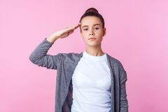 Free Yes Sir! Portrait Of Obedient Brunette Teenage Girl Giving Salute Listening To Order With Serious Responsible Expression. Pink Royalty Free Stock Photo - 169800185