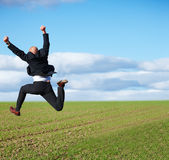 Yes - Successful business man jumping Royalty Free Stock Images