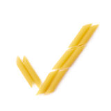 Yes tick sign made of penne pasta Stock Photography