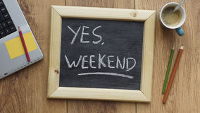 Yes, weekend. Written on a chalkboard at the office Stock Images