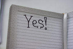 Yes!. Yes the word of the letters written in the notebook line black marker Royalty Free Stock Photography